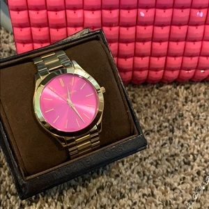 Gold and pink face Michael kors watch